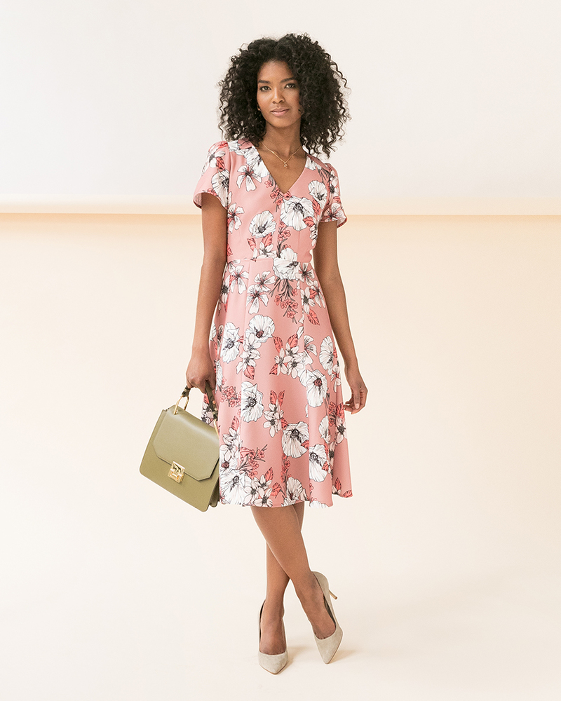 Model wearing cap sleeve floral dress from Ivanka Trump Collection.